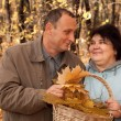 Old man and old woman in autumnal forest — Stock Photo #7430956