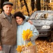 Old man and old woman in autumnal forest — Stock Photo #7430977