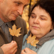 Old man and old woman in autumnal forest — Stock Photo #7430991