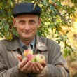 Thoughtful middleaged man with apples - Stock Photo