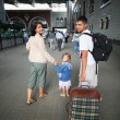 Happy family with little girl at railway station — Stock Photo