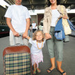 Happy family with little girl at railway station, focus on daugh — Stock Photo