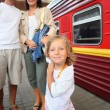 Happy family with little girl at railway station, focus on daugh — Stock Photo #7431073