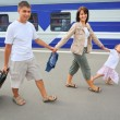 Stock Photo: Happy family with little girl going on railway station