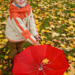 Umbrellas in autumn park — Stock Photo