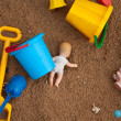 The thrown toys in a sandbox — Stock Photo