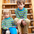 Stock Photo: Brother and sister on children's playground in identical c