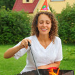 Young woman near in cap brazier on picnic, happy birthday - Stok fotoraf