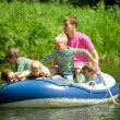 Children go for a drive on an inflatable boat under supervision — Stock Photo
