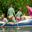 Children and adults float on an inflatable boat — Stock Photo