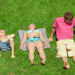 Family with boy resting on the grass, view from up — Stock Photo