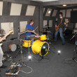 Rock band is working in studio - Stock Photo