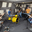 Rock band is working in studio — Stock Photo #7431337