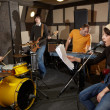 Rock band is working in studio — Stock Photo #7431339