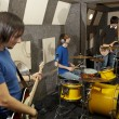 Rock band is working in studio — Stock Photo #7431356