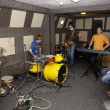 Stock Photo: Rock band is working in studio