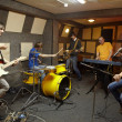 Постер, плакат: Rock band is working in studio
