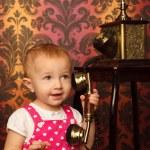 Little girl & old phone — Stock Photo #7431472