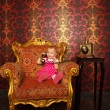 Little girl & old armchair — Stock Photo