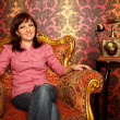 Portrait of girl sitting in armchair — Stock Photo