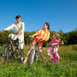 Family from three persons on bicycles in the country. Mum with a — Stock Photo