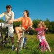 The father, mum and daughter on bicycles in park. To keep the fr — Stock Photo #7431678