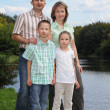 Family in early fall park — Stock Photo #7431758