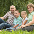 Family in early fall park — Stock Photo #7431778