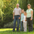 Family in early fall park — Stock Photo #7431820