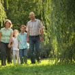 Family in early fall park - Stock Photo