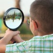 Through magnifier — Stockfoto