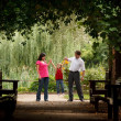 Family in park — Stock Photo #7431993