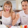 Married couple having breakfast at restaurant, eating cream whea — Stock Photo