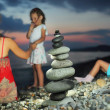 Two little girls and beautiful woman in red sundress sitting nea — Stock Photo