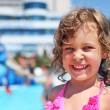 Stock Photo: Pretty little girl near pool in aquapark of entertaining comp