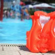 Orange lifejacket near pool in aquapark — Stock Photo