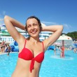 Stock Photo: Smiling beautiful womstanding in pool of entertaining comp