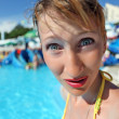 Surprised young woman standing in pool of an entertaining comple — Stock Photo