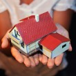 Model of house with garage on hands — Stock Photo