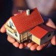 Model of house with garage on hands — Stock Photo #7432451