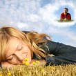 Royalty-Free Stock Photo: Young woman lies on the grass and boy in dream cloud collage
