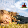 Young woman lies on the grass and boy in dream cloud collage - Stok fotoraf