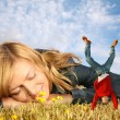 Young woman lies on the grass and miniature boy on hands collage — Stock Photo