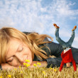 Young woman lies on the grass and miniature boy on hands collage - Stock Photo