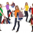 many happy blondes with rainbow color dress and paper bags full — Stock Photo
