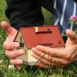 Holding house miniature — Stock Photo