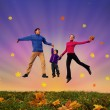 Jumping family with boy on autumnal meadow collage — Stock Photo #7432549