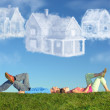 Lying couple on grass and dream three cloud houses collage — Stock Photo