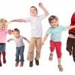 Many jumping children on white — Stock Photo