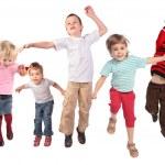 Many jumping children on white — Stock Photo